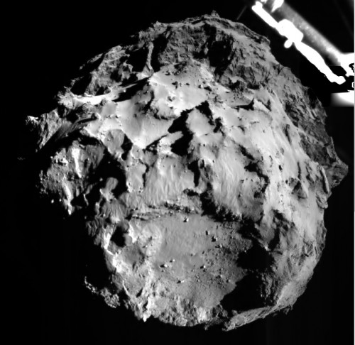 The image shows comet 67P/CG acquired by the ROLIS instrument on the Philae lander during descent on Nov 12, 2014 14:38:41 UT from a distance of approximately 3 km from the surface. The landing site is imaged with a resolution of about 3m per pixel.